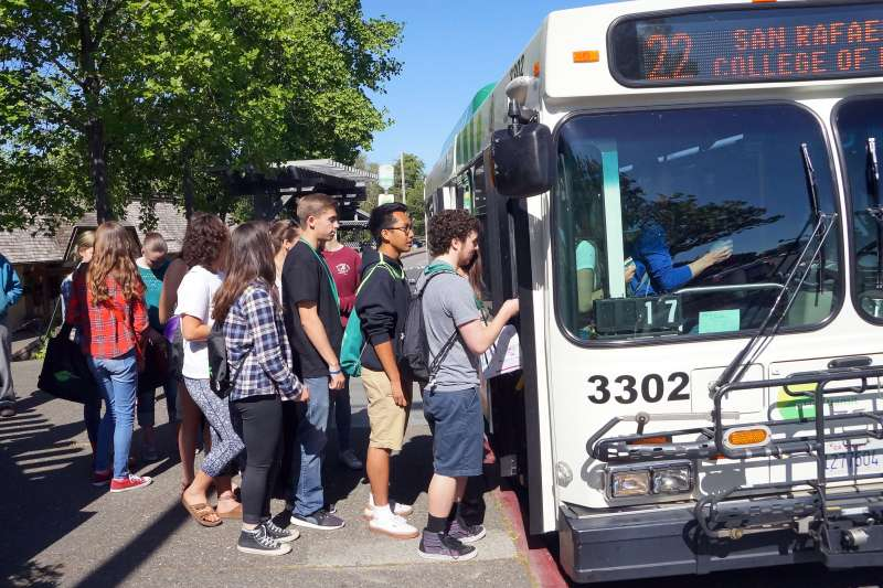 Photo of a group of students boarding a bus, ready to start the Amazing Transit Race